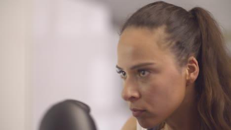 CU-Of-Lady-punching-a-Boxing-Bag