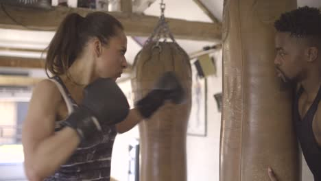 Woman-and-Man-Training-in-Boxing-Gym