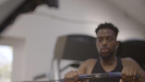 Cu-of-Man-Rowing-in-Gym