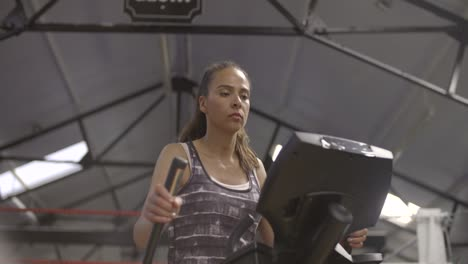 Woman-Using-Cross-Trainer-in-Gym
