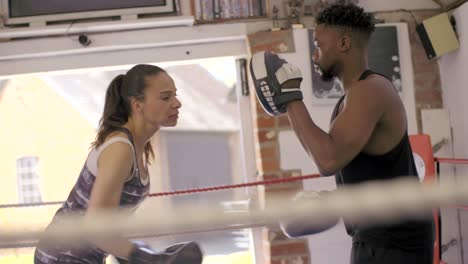 Tracking-Shot-of-Boxers-Training-in-Ring