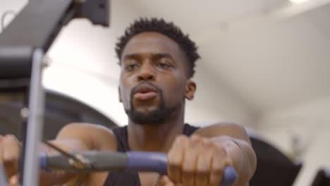 Man-Using-Rowing-Machine-in-Gym