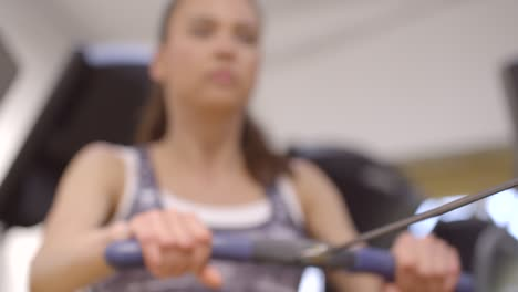 Close-Up-shot-of-Woman-Using-Rowing-Machine