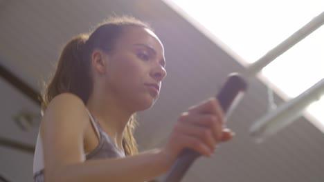 Woman-Using-Running-Machine-in-Gym