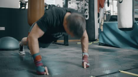 Man-Doing-Press-Ups-in-Boxing-Gym