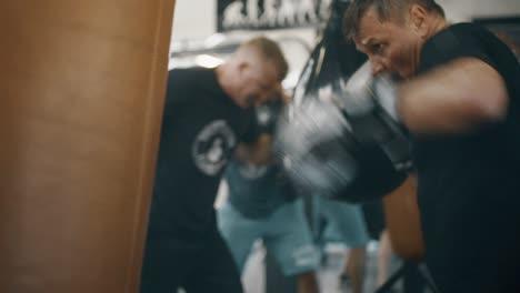 Man-Hitting-Large-Punch-Bag