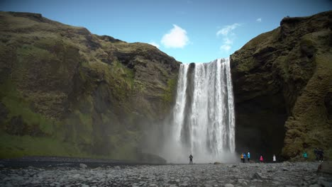 People-at-the-Base-of-Large-Waterfall