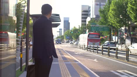 Commuter-at-Bus-Stop-in-Seoul