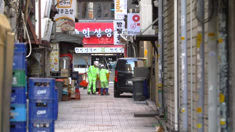 Street-Cleaners-Working-in-Back-Street