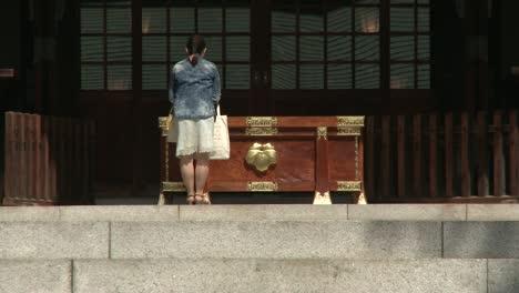 Woman-Praying-in-Temple