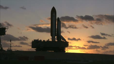 Silhouetted-Space-Shuttle-on-Crawler-Transporter