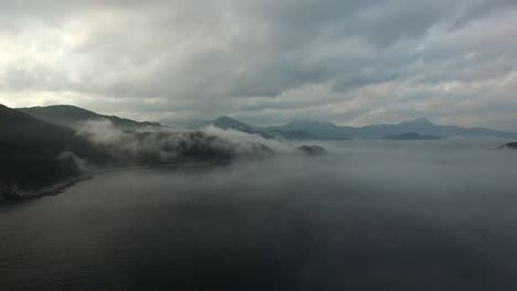 Flying-Over-Misty-Coastline