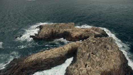 Flying-Over-Rocky-Island-Coastline