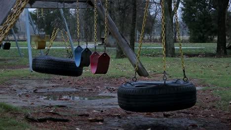 Bleak-Abandoned-Park-Tire-Swings