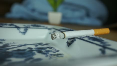 Lit-Cigarette-Brurning