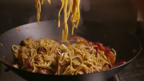 Stirring-Noodles-in-Wok