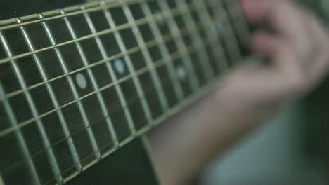 Acoustic-Guitar-Strings-Vibrating