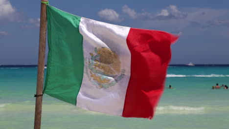 Mexican-Flag-Flying-On-Beach