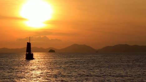 Asian-Sailboat-Floating-on-the-Sunset-Waters