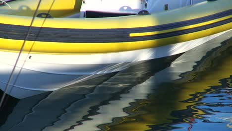 Yellow-Speedboat-Moored-in-Harbour
