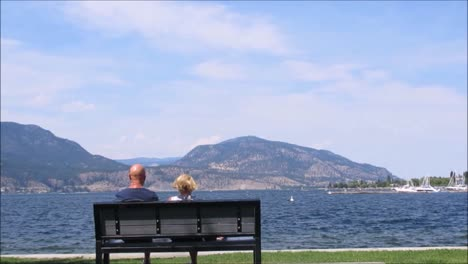 Couple-Sitting-by-the-Lake