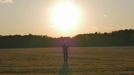 Man-Walking-into-Sunset-4k