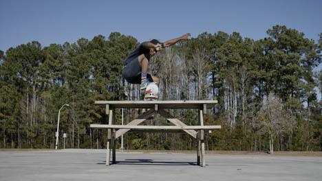 Skateboarder-Picnic-Table-Jump
