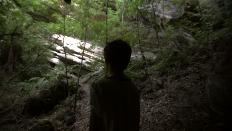 Silhouetted-Young-Boy-Looking-out-of-Cave