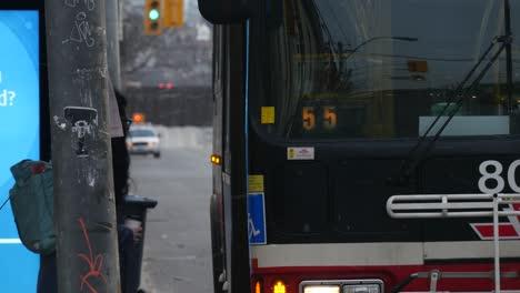 Woman-Boarding-Bus