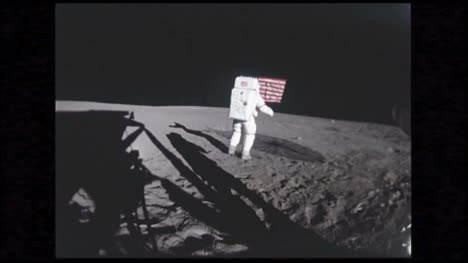 Astronaut-Holding-American-Flag-on-Moon