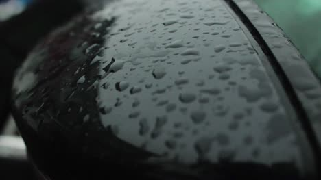 Rain-Drops-Hitting-a-Car-Wing-Mirror