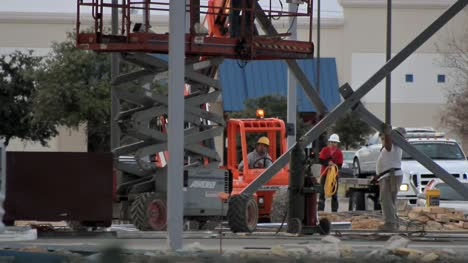 Construction-Workers-Removing-A-Beam-1