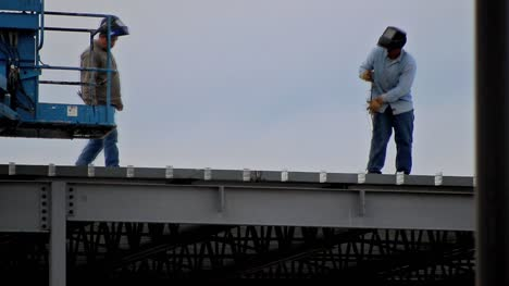 Construction-Working-Welding-on-Roof