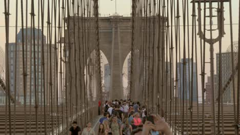 A-Crowd-of-People-Walking-Across-Brooklyn-Bridge