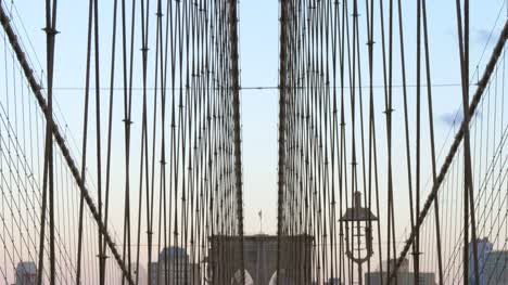 Panning-Down-to-show-Poeple-Walking-Over-Brooklyn-Bridge