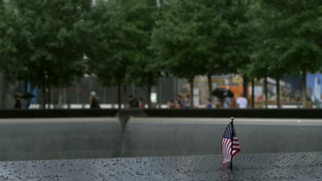 Focus-Pull-on-USA-Flag-in-Plaque-at-911-Memorial