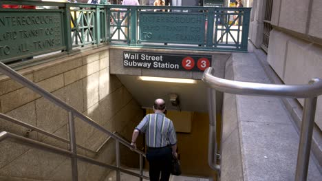 Elderly-Man-Going-into-Wall-Street-Subway-Station
