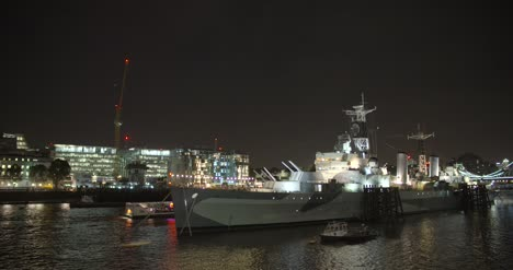 Smaller-Ship-Passing-HMS-Belfast-on-the-River-Thames