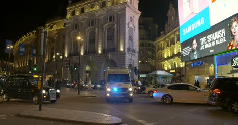 Ambulance-Speeding-through-Piccadilly-Circus-at-Night