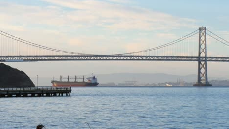 Ship-Passing-Oakland-Bay-Bridge-at-Dawn