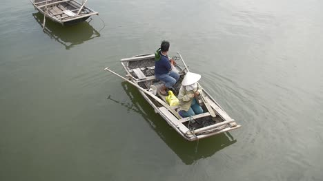 Slow-Motion-Tilting-Shot-of-a-Traditional-Vietnamese-Fishing-Boat