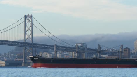 Cargo-Ship-Passing-Under-San-Francisco-Bridge
