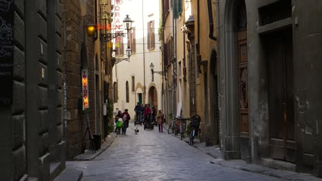 Tourists-Riding-Segways-Down-a-Small-Street