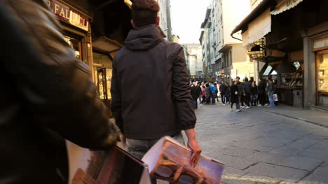 Tourists-Walking-Across-Ponte-Vecchio