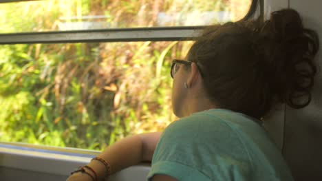 Tourist-Looking-out-of-Train-Window-in-Sri-Lanka