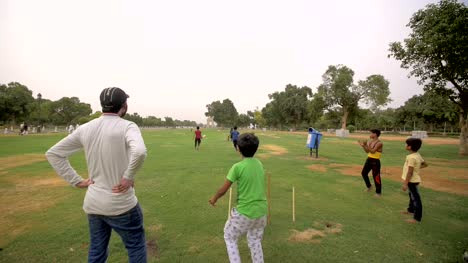 Indian-Children-Playing-Cricket-in-a-Park