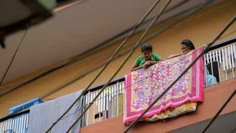 Indian-Girl-and-Woman-Talking-on-a-Balcony