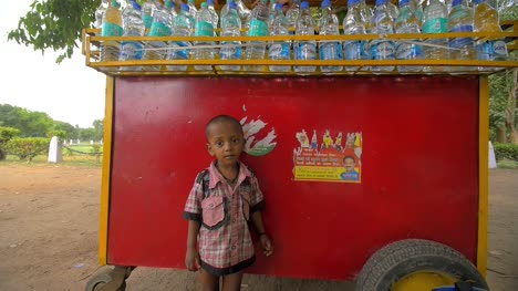 Indian-Vendor-and-Children-at-a-Drinks-Stall