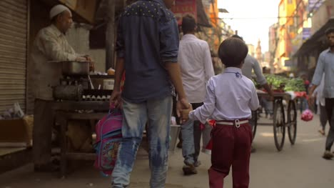 Father-and-Child-Holding-Hands-on-Busy-Street
