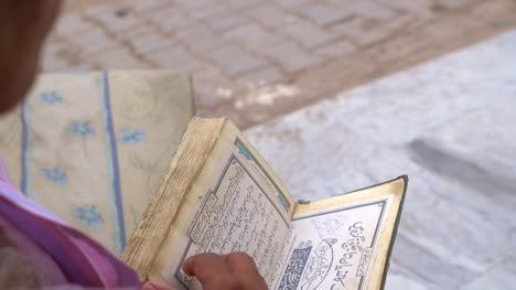 Man-Looking-Through-Quran